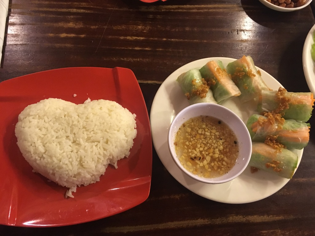 Reunion dinner. Steamed spring rolls and rice in the shape of a heart.